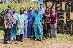 Emory ophthalmologists, including Steven Yeh, and physician-patient Ian Crozier with clinicians at ELWA Hospital in Monrovia, Liberia.