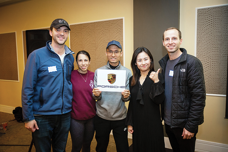 Third-place winning team includes, from left,  Nick Ramsey, Elizabeth Hitti,  Linxi Wu, Shuo Sun, Jim Sandeford. Not pictured: Michelle Pham. Photo taken last fall during Reveal Day, where students learned of consulting assignments.