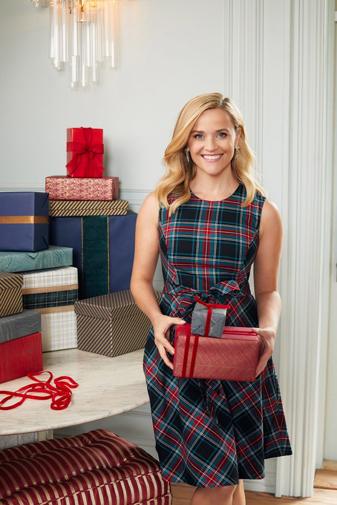 Reese Witherspoon, actress, author, lifestyle expert, and founder of Draper James, shown here in the Love Circle Dress in Georgia plaid. The Love Circle is Draper James' brand loyalty program