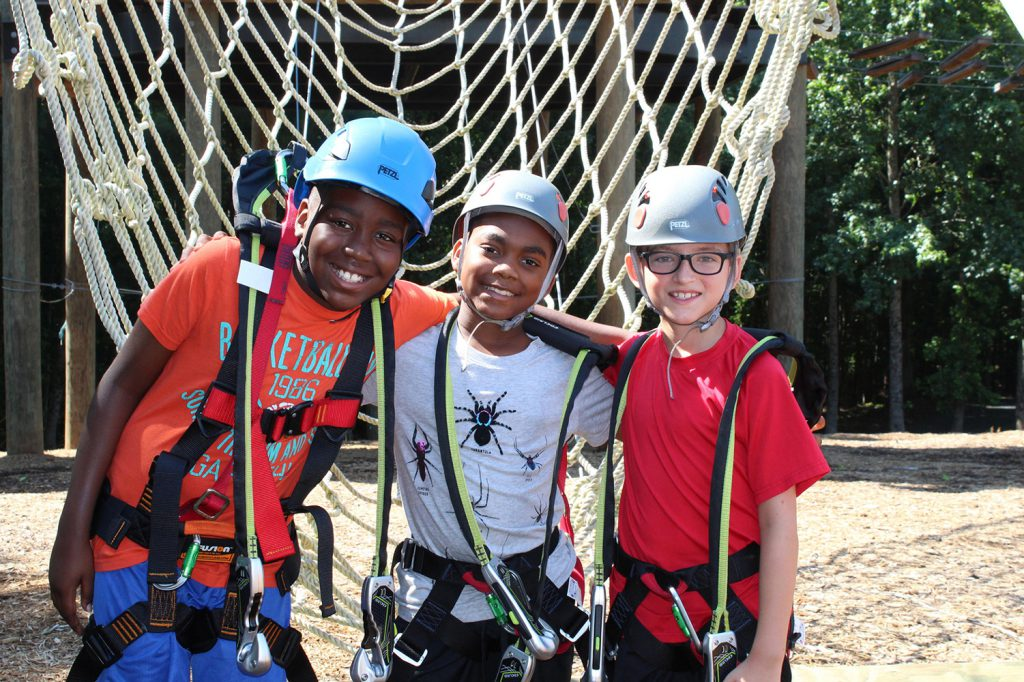 3 boys are ready to climb at Camp Southern Ground