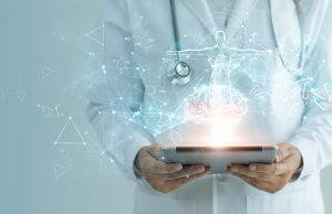 A doctor holds a holographic tablet computer