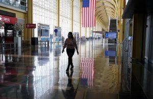 Lone figure walking through Reagan International Airport