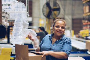 A worker at First Step Warehouse