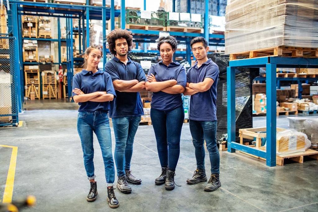 Four team players in the warehouse